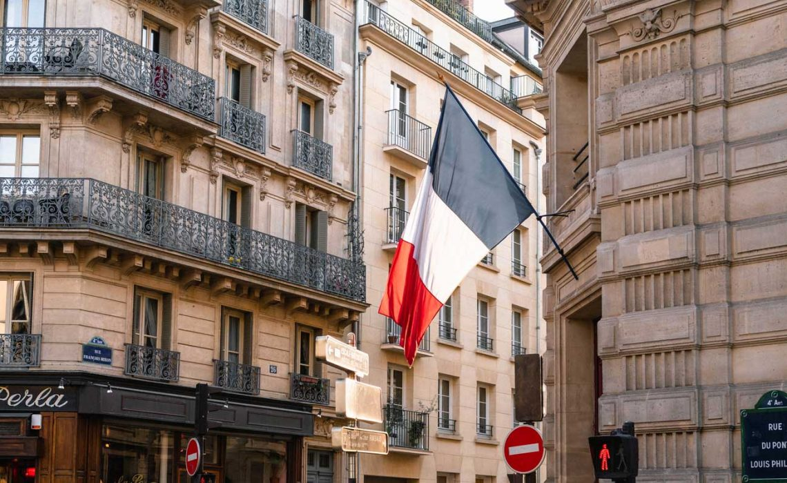 france-flag-on-gray-concrete-building-near-road-2272939
